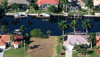 Picture link to gulf access lots for sale in the South of Cape Coral up from $100,000 to $149,999
