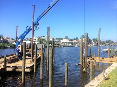 Picture showing a barge installing pilings in the water