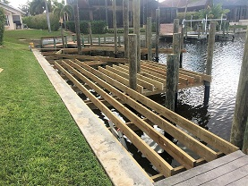 Picture showing a the finished framing of the boat deck with wood trusses