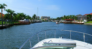 Picture showing a Boat going through a Cape Coral canal