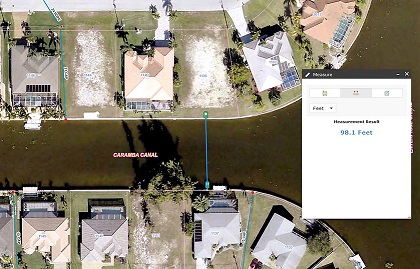 Picture of a Cape Coral property on a canal where the canal width is being measured