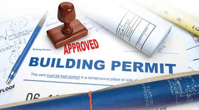 Picture of a building permit with an approved stamp on it