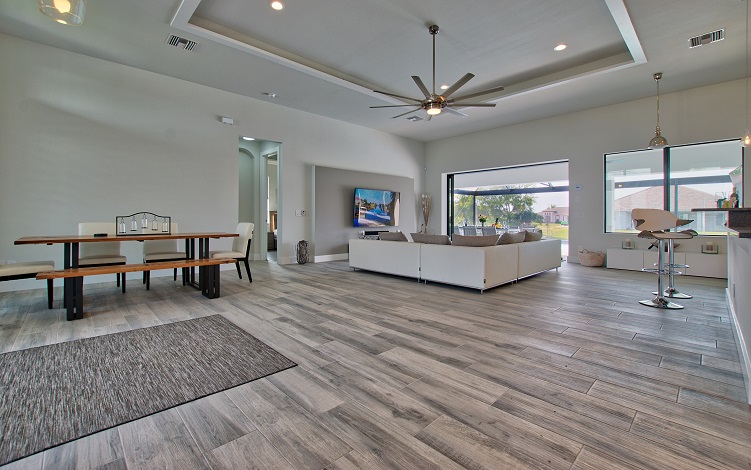 Picture of the New Construction Model Beach Cove viewing the living area and dining room