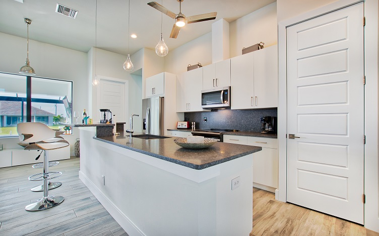 Picture of the New Construction Model Beach Cove viewing the kitchen