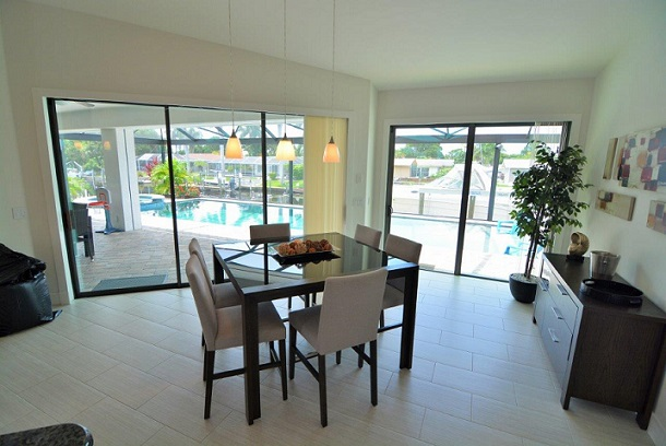 Picture of the New Construction Model Coral Laguna 2 showing the dining area overlooking the pool deck
