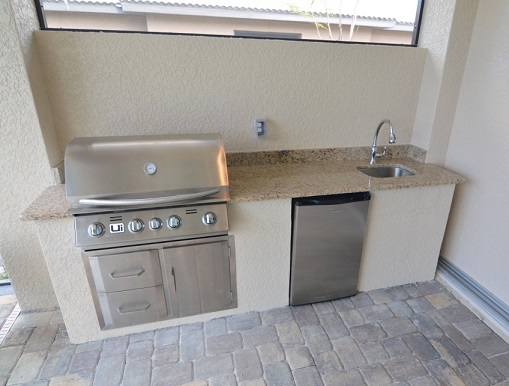 Picture of the New Construction Model Sunset Bay 2 version 1 showing the summer kitchen with grill, fridge and sink