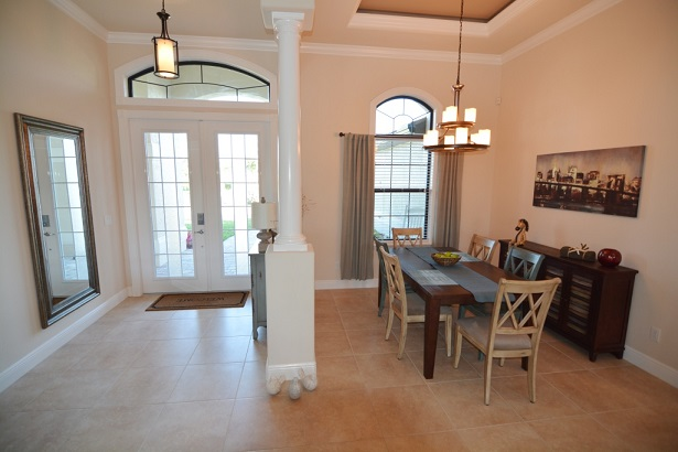 Picture of the New Construction Model Sunset Bay 2 version 1 showing the entrance and dining area