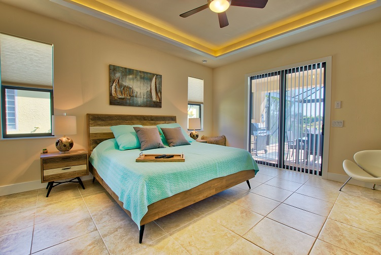 Picture of the New Construction Model Sunset Bay 2 version 2 showing the master bedroom view to the pool