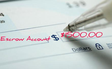Picture of an escrow deposit check being filled in