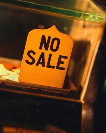 Bild mit einem Schild und der Aufschrift Haus nicht verkauft