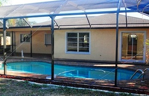 Picture of the lanai with pool and screen after renovation